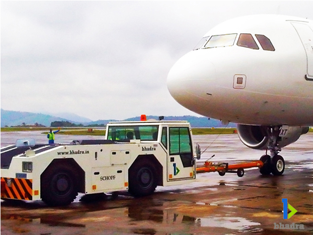 Bhadra International push back tractor handling the aircraft